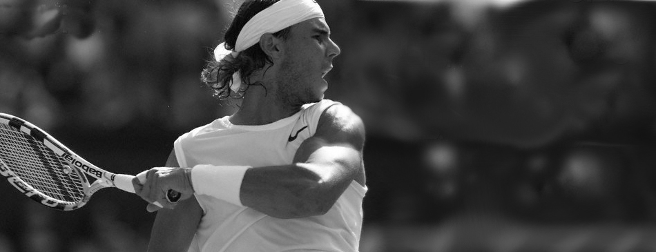 Ragael Nadal playing tennis with passion